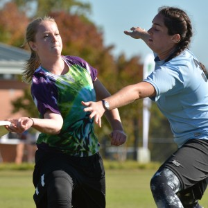 Alison Fowler, junior in marine science, passes the disc during the Women's Club Ultimate Wolfpack Invitational ultimate frisbee tournament Saturday, Oct. 25, 2014. Both men's and women's clubs hosted tournaments over the weekend, with teams from UNC-Chapel Hill, UNC-Greensboro, UNC-Asheville, Duke, Elon, Applachain State, and Virginia were in attendance. The men's and women's ultimate teams are two of 44 different club sports at N.C. State, offering students the opportunity to compete in various activities, including cycling, fencing, sailing, equestrian, water polo, and rugby. By: John Joyner