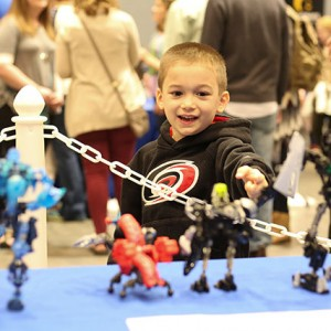 Anthony, a five year old, excitedly points out another bionicle creation made by Richard Roth. The BrickUniverse Raleigh LEGO Fan Convention was held in Raleigh Convention Center on April 2nd and 3rd and drew hundreds of people to enjoy LEGO based shops, exhibitions, and activities.