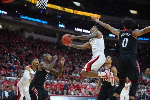 Redshirt junior guard Trevor Lacey shoots the ball during the basketball game against Cincinnati in PNC Arena Tuesday, Dec. 30, 2014. The Bearcats defeated the Wolfpack, 76-60. By: John Joyner