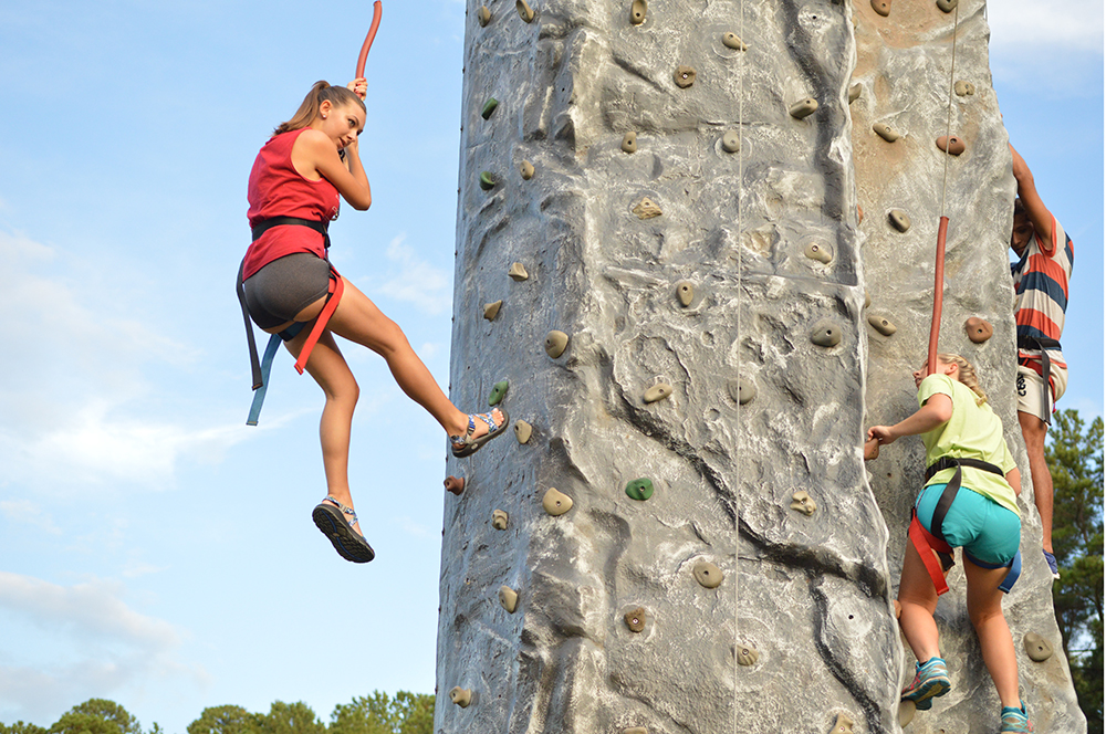Abigail Farlow, a freshman studying industrial engineering, rappels down a rock wall durign RecFest on Miller Field on Sunday, August 14, 2016.