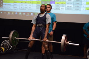 [Special Olympian Brian Carter demonstrates a deadlift]