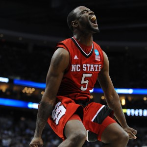Senior guard Desmond Lee jumps and screams after N.C. State defeated Villanova during the 3rd round of the NCAA Tournament Saturday, March 21, 2015. The Wolfpack defeated the No. 1 seed Wildcats 71-68 at CONSOL Energy Center in Pittsburgh, PA to extend their run in the tournament to the Sweet Sixteen. By: Ryan Parry