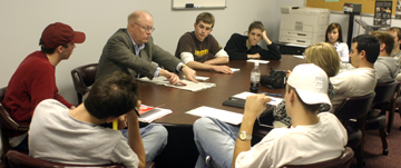 Bill Elsen discusses that day's edition with the editorial board of the Technician. Elsen, a former editor with The Washington Post, came in the first week of school in the spring semester to work with reporters and other staff members of the Technician, Agromeck and Nubian Message.